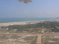 Cam Ranh Airport, Nha Trang Viet Nam (VVCR) - Aerial view of runway after takeoff. - by John Grummitt
