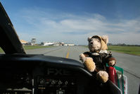 Invercargill Airport, Invercargill New Zealand (NZNV) - Pierre the Pilot, round-the-world bear taxies towards the terminal and tower at Invercargill NZ - see www.bearintheair.org for his story! - by Pete Hughes