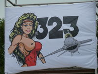Leeuwarden Air Base Airport, Leeuwarden Netherlands (EHLW) - Goddess of the hunters Diana is in the squadron-sign of Leeuwarden based 323 Squadron, this banner was high up during the Royal Netherlands Air Force open house - by Alex Smit
