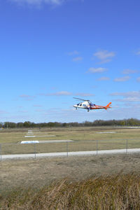 Bell Training Facility Heliport (3XS7) - Texas Motor Speedway Heliport - CareFlite N144CF landing during the Boy Scout Camporee - by Zane Adams