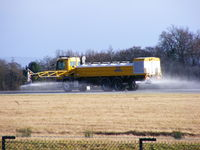Manchester Airport, Manchester, England United Kingdom (EGCC) - Spraying deicer on the runway  - by chris hall