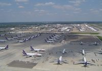 Memphis International Airport (MEM) - Amazing sight of part of the extensive Fedex ramp containing over 100 aircraft (A300-600,A310,MD11,DC10,B727 and ATR42), taken whilst on approach to 18R. Later that Afternoon a mass departure of 80 of these aircraft left in just 90 minutes, also visible i - by keith sowter