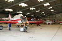 Lashenden/Headcorn Airport, Maidstone, England United Kingdom (EGKH) - Inside the main hangar - view two. - by Martin Browne