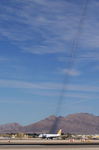 Mc Carran International Airport (LAS) - I found this very bizarre: the sun was in the right position to cast a shadow of overhead contrails on the mountain in the background.  Ted Airlines N470UA awaiting take-off - by Brad Campbell