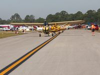 Lakeland Linder Regional Airport (LAL) - Three Champs lining up to depart Sun N Fun 2009. - by Bob Simmermon