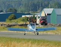 Auburn Municipal Airport (S50) - airport improvement machinery on taxiway - by Wolf Kotenberg