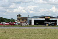 Peterborough Business Airport, Peterborough, England United Kingdom (EGSF) - A view across the runway threshold to Conington Control Tower - by Terry Fletcher