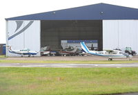Leeds Bradford International Airport, West Yorkshire, England United Kingdom (EGNM) - GA hangar at Leeds Bradford Airport - by Chris Hall