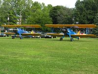 Noblesville Airport (I80) - N9HY (L) and N49711 (R) at the EAA fly-in - by Bob Simmermon