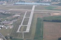 Findlay Airport (FDY) - Looking east at the construction work.  Note the illuminated X on RWY 7 - by Bob Simmermon