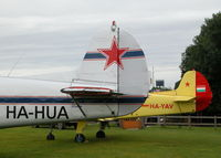 Popham Airfield Airport, Popham, England United Kingdom (EGHP) - YAK 18T'S OUTSIDE THE CLUB HOUSE, UNFORTUNATELY HA-HUA ALWAYS HAS THE COVERS ON WHEN I'M AT POPHAM - by BIKE PILOT