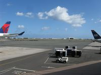 Honolulu International Airport (HNL) - A view of the ramp area between the Central Concourse (right side) and the Diamond Head Concourse (left side). - by Kreg Anderson