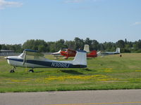 Grand Rapids/itasca Co-gordon Newstrom Fld Airport (GPZ) - A grassy area complete with tied down aircraft. Seems...nostalgic :) - by Kreg Anderson