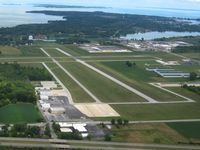 Carl R Keller Field Airport (PCW) - Looking NE down RWY 36, Put-In-Bay Island beyond - by Bob Simmermon