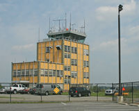 Morristown Municipal Airport (MMU) - The control tower is original; the rest of this once quiet airport is surrounded by a panopoly of operators of private jets. - by Daniel L. Berek