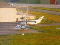 Hawarden Airport, Chester, England United Kingdom (EGNR) - CS-DMM and CS-DRB outside of the Hawker Beechcraft hangar as we arrive back at Hawarden - by Chris Hall
