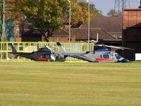 RAF Shawbury Airport, Shawbury, England United Kingdom (EGOS) - Agusta A-109E's, ZR325 and ZR324 of the Defence Helicopter Flying School - by Chris Hall