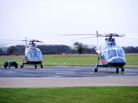 RAF Shawbury Airport, Shawbury, England United Kingdom (EGOS) - ZR324 and ZR325 Agusta A-109E's of the Defence Helicopter Flying School - by Chris Hall