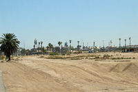 Calexico International Airport (CXL) - Mexico as seen from the airport parking lot looking South. - by Marty Kusch