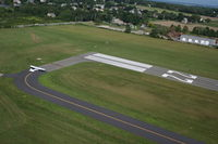 Newport State Airport (UUU) - in a R-44 over Newport RW 22 - by Levi C. Maaia