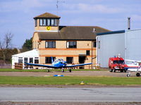 Peterborough Business Airport - Tower and club house at Conington with PA-28 G-LSFI - by Chris Hall