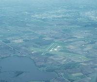 Mankato Regional Airport (MKT) - Looking west toward the airport. Taken from N7680U. - by GatewayN727
