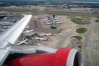 London Heathrow Airport, London, England United Kingdom (EGLL) - Passing Terminal 4 and the new control tower at London Heathrow as seen from Airbus G-DBCG in 2008.  - by Malcolm Clarke