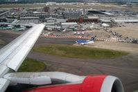 London Heathrow Airport, London, England United Kingdom (EGLL) - A view across Terminals 1, 2 and 3 at London Heathrow as seen from Airbus G-DBCG on take off en route to Newcastle in July 2008. - by Malcolm Clarke