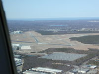 Long Island Mac Arthur Airport (ISP) - Landing at Islip on a clear March morning. - by Paul Beyer