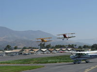 Santa Paula Airport (SZP) - N53EH and N3G in tandem takeoff Rwy 22 at the National Bucker Fly-In - by Doug Robertson