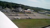 Beverly Municipal Airport (BVY) - Me taking off runway 16. Passenger got this great photo! - by Samuel D.