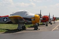 Wittman Regional Airport (OSH) - T-28's on the flightline.  First T-28 might be N81643 - by Timothy Aanerud