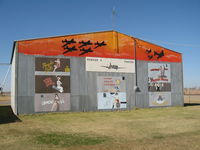 Enid Woodring Regional Airport (WDG) - Hangar art at Enid - by Adserak