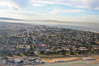 Los Angeles International Airport (LAX) - El Segundo California, as seen on a 25R departure, truly one of the friendliest towns in the US... - by Mark Kalfas