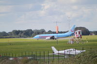 Norwich International Airport, Norwich, England United Kingdom (EGSH) - TUI 737 taxi's in whilst a Cherokee awaits departure. - by Graham Reeve