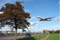 London Heathrow Airport, London, England United Kingdom (EGLL) - Virgin A340 returns to home base at London Heathrow - by Terry Fletcher