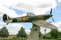RAF Lakenheath - Supermarine 349 Spitfire F5 (replica) BM361 / XR-C in the commemorative area at RAF Lakenheath. Painted in the colours of 71 Eagle Sqn, a touching tribute to Fighter Command from the USAF's 48th Fighter Wing. - by Malcolm Clarke