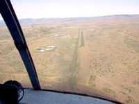 West Valley Airport (48WA) - On approach (with Tim Robel) from the east looking west. The airstrip rises to meet you at about a 2.4% rise or 100' rise in the 2,400' length. More hangar/homes have been built since this photo was taken. - by Terry Irwin