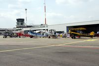 Antwerp International Airport - Part of the tarmac;with behind the museum and tower.SV-4's lined up OO-PAX OO-GWB OO-SVB OO-KAT OO-GWC - by Robert Roggeman