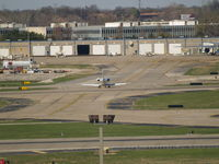 Lambert-st Louis International Airport (STL) - HEADING AWAY FROM CAMERA TOWARD NORTHEND OF HANGERS - by Gary Schenaman