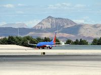 Mc Carran International Airport (LAS) - Southwest Airlines / Shimmering in the afternoon heat ready for take-off on RWY 25R. The mountain in the background is a Volcano. - by SkyNevada - Brad Campbell