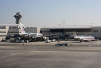 Los Angeles International Airport (LAX) - View on some AA aircrafts from the Air Tahiti Nui terminal. - by olivier Cortot