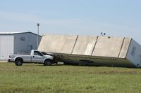 Lakeland Linder Regional Airport (LAL) - Storm damage from the 3/30/11 microburst/tornado.  Trailer blown down onto a Ford F250 - by Florida Metal