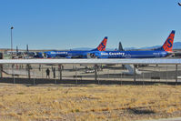 Laughlin/bullhead International Airport (IFP) - Two Sun Country B737s and Three US Marines Hercules on the Bullhead / Laughlin apron - by Terry Fletcher