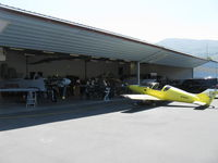 Santa Paula Airport (SZP) - Aviation F/X, Assorted Experimental aircraft. In build hangar. Pulsar on apron. Just a visible bit of a Turbine Legend fuselage hanging from ceiling storage-upper left.  - by Doug Robertson
