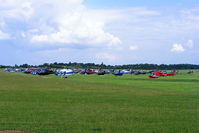 Turweston Aerodrome Airport, Turweston, England United Kingdom (EGBT) - Sixty helicopters at Turweston used for ferrying race fans to Silverstone for the British F1 Grand Prix - by Chris Hall