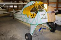 Parr Airport (42I) - Airport owner Chuck Norman showed us his Cub restoration while at the EAA fly-in. - by Bob Simmermon