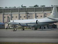 Cecil Airport (VQQ) - Customs P-3 on ramp at KVQQ - by John J. Boling