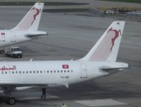 Paris Orly Airport, Orly (near Paris) France (LFPO) - Tale of two tails. Tunisair A320 TS-IME had just docked to gate as TU 722 from Tunis. Sister-ship Mike-November was being serviced in anticipation of her return to Djerba - by Alain Durand