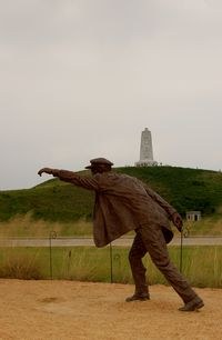First Flight Airport (FFA) - Sculpture of Wilber Wright at the 1903 Wright Flyer Sculpture at the Wright Brothers National Memorial, Kill Devil Hills, NC - by scotch-canadian